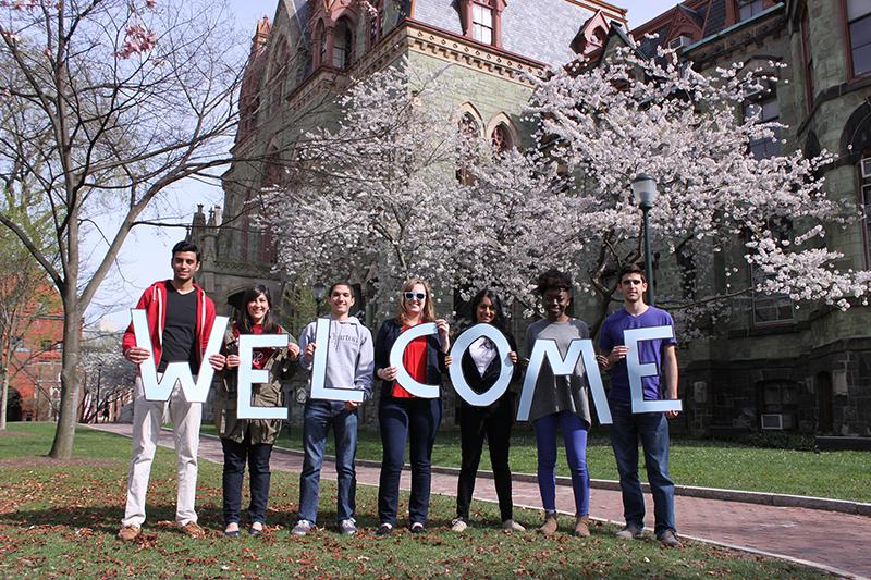 Students holding welcome sign